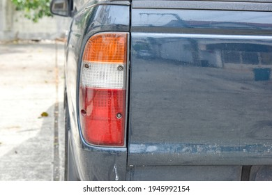 close up of car taillight with old color, old taillight light of car taillight not bright