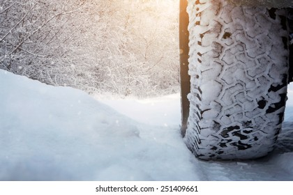Close up of car tire on the snowy road with copy space
