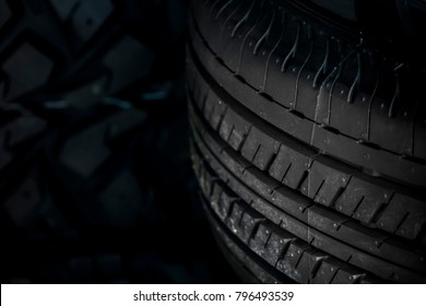 Close up car tires isolated on black background