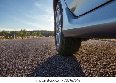 Close up of car wheels on asphalt road, travel concept, aim