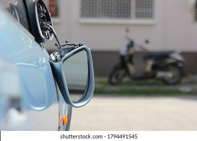 Close up car wing mirror, side view mirror broken from accident. Car insurance concept.
