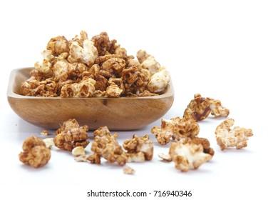 Close - up Caramel chocolate popcorn on white background