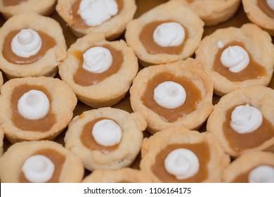Close up of caramel cup wedding cookies.