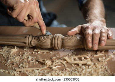 Close up carpenter's hands that work with cutter