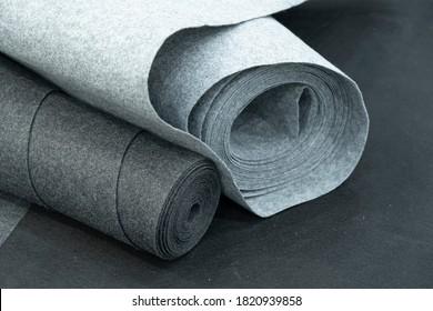 Close up of carpet rolls. Polyester or felt carpets background