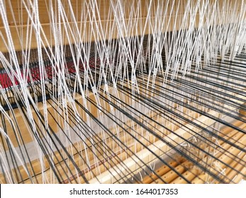 Close up of carpet weaving on loom. Closeup of threads in a loom used for weaving rag carpets