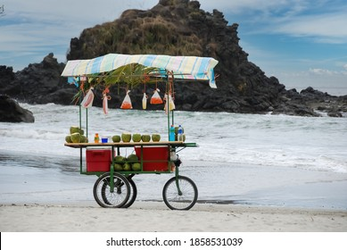Close up of a cart on a beach in Costa Rica selling fresh fruit, drinks and coconut water to tourists