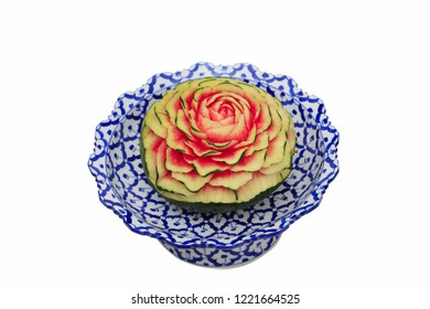 close up Carved fruit on traditional Thai plate call Benjarong Base, flower shape of carved fruit