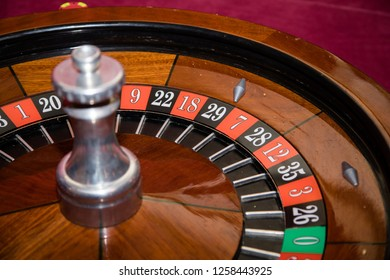 A close up of a casino roulette wheel