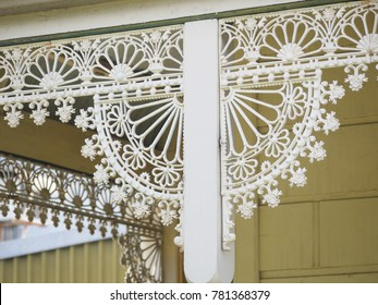 Close up of cast-iron lacework on typical Victorian style old architecture facades. Old houses decorated with these kind of iron lacework are common in Melbourne's inner residential suburbs.