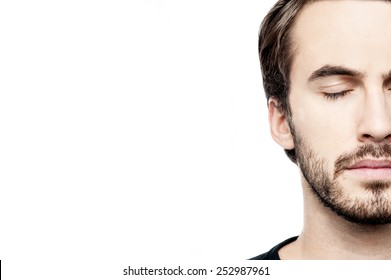 Close up of casual man face posing over white