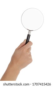 close up caucasian female hand holding a magnifying glass on studio isolated white background