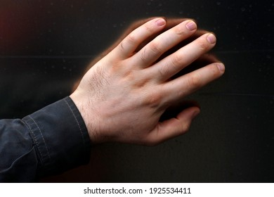 Close up of a Caucasian male left hand