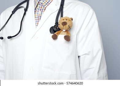 Close up of caucasian pediatrician with stethoscope and teddy bear in his breast pocket