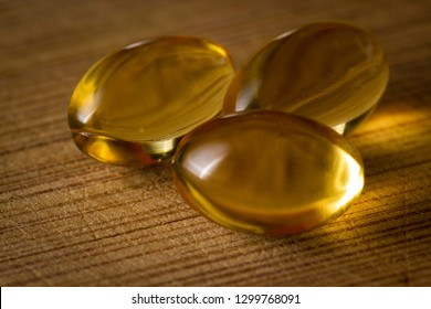 close up of CBD oil capsules made from hemp on a wooden table