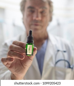 close up of CBD oil and Doctor