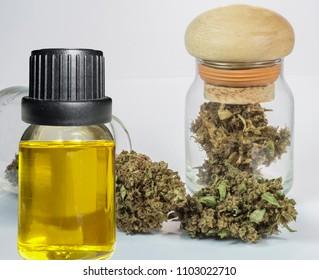 close up of CBD oil and marijuana buds