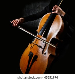 Close up of a cello musician on dark background