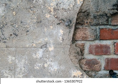 close up of cement patch over weathered red brick wall