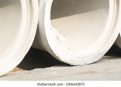 close up cement water pipe at construction site , Drainage white color with light and shadow .