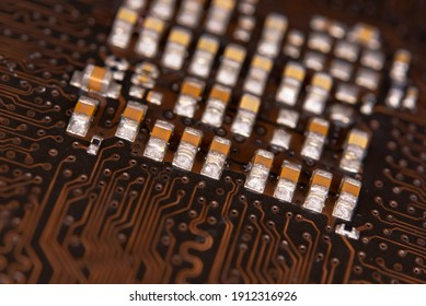 close up ceramic capacitors on electronic circuit board