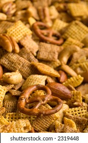 Close Up of cereal, pretzel, and nut snack mix background
