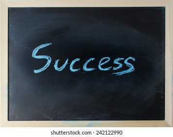 close up of chalkboard with success topic