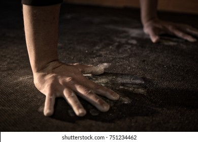 Close up of chalky hands on floor during gym workout