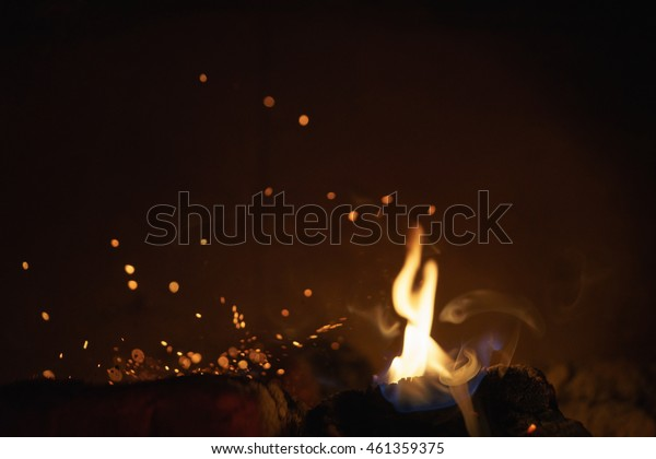 close up of charcoal burning in fireplace