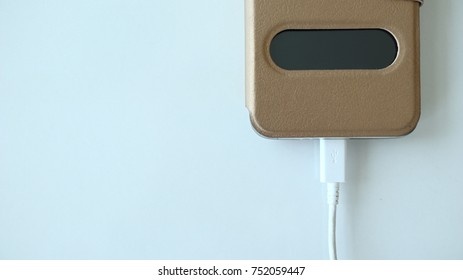 close up charger insert to smartphone on table with copyspace