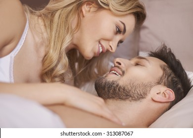 Close up of charming young couple during the foreplay