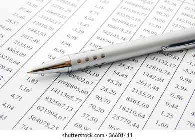 close up of a chart with a pen