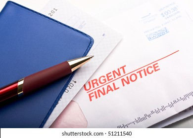 "Close up of check book over a business mail labeled ""Urgent final notice"". Concept of past due payment."