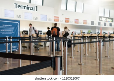 Close up of check-in area with belt control queue at international airport Vienna Austria. Queue barrier for waiting.