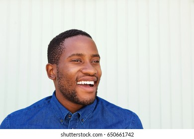 Close up cheerful young african man in denim shirt