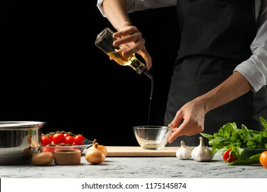 Close the chef's hands, preparing an Italian tomato sauce for macaroni.pizza. The concept of the Italian cooking recipe