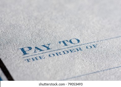 Close up of a cheque book focus on Pay To