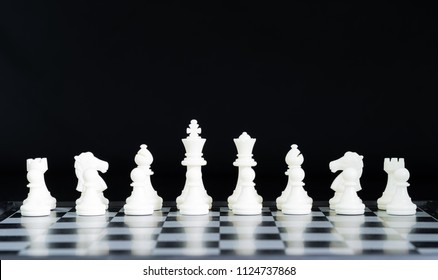 Close up chess pieces on chessboard, Set of chess figures on the playing board