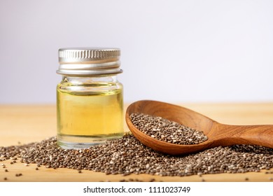 Close up a Chia essential oil and seeds in wooden spoon , superfood and rich of nutrient an antioxidant