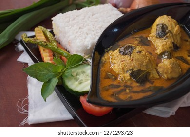 close up of chicken basil is ayam kemangi is an indonesia food made from chicken soaked with herb and spices, presenting with rise, bean sprouts, tomato, cucumber, carot and long beans as vegetable