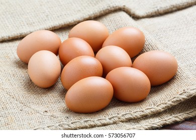 Close up chicken eggs on sack cloth background