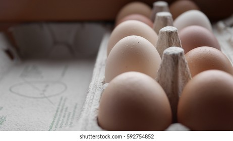 Close up of chicken eggs in tray