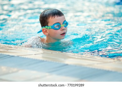 Close up of child boy swimming in pool.