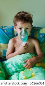 close up of child making inhalation