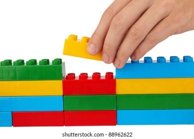 close up of child toy bricks construction isolated on white background