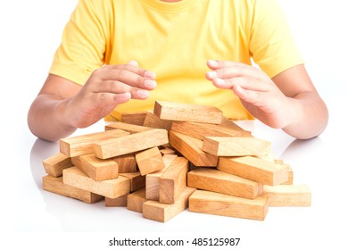 Close up children hand protect blocks wood game (jenga) isolated on white background. Risk concept