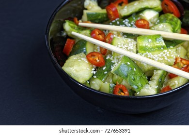 Close up of chinese broken cucumbers with sesame oil, pepper and garlic