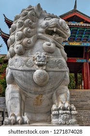 Close Up of Chinese Imperial Guard Lion (Foo Dog) at Steps of Historic Buddhist Temple Monastery in Baisha, Yunnan, China.