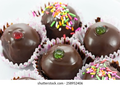 Close up chocolate ball with topping in paper cup