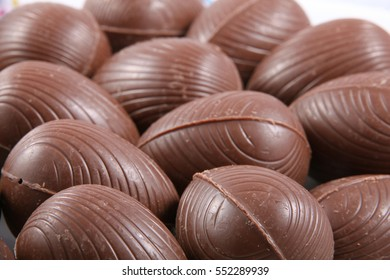 Close up of chocolate easter eggs, with the wrappers off ready to eat.
